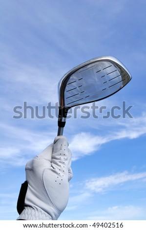 Golfer Wearing a Golf Golf Holding a Metal Driver - stock photo