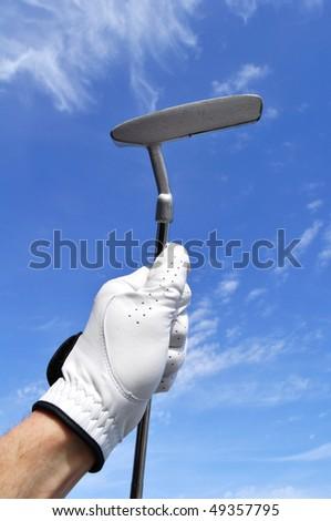 Golfer Wearing a Golf Golf Holding a Putter - stock photo