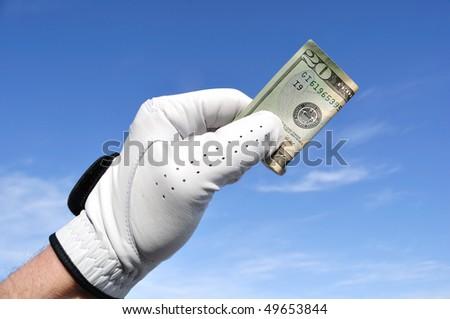 Golfer Wearing Golf Glove Holding a Twenty Dollar Bill - stock photo