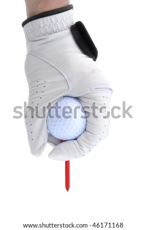 Golfer Wearing Golf Glove Teeing Up a Golf Ball on a Red Tee - stock photo