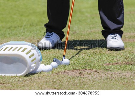 golfer with golf club during practice - stock photo