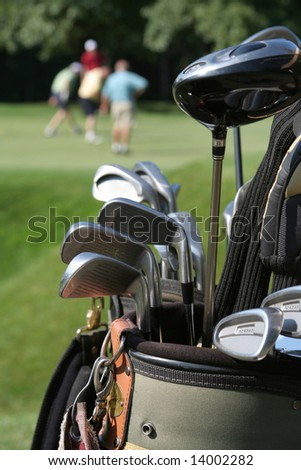 GOLFERS AND GOLFBAG - stock photo