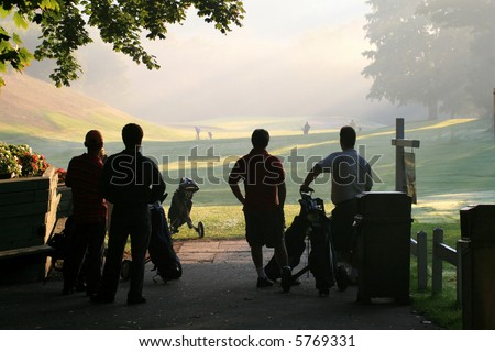 Golfers Await their Turn to Play. - stock photo