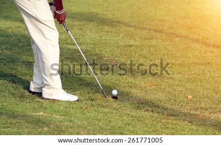 Golfers hit golf course in the summer on sunshine for relax time - stock photo