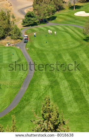 Golfers on bright green fairway, 		Crooked River Canyon,	Central Oregon