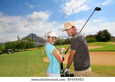 Golfers on golf course - stock photo