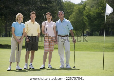 Golfers on Putting Green - stock photo