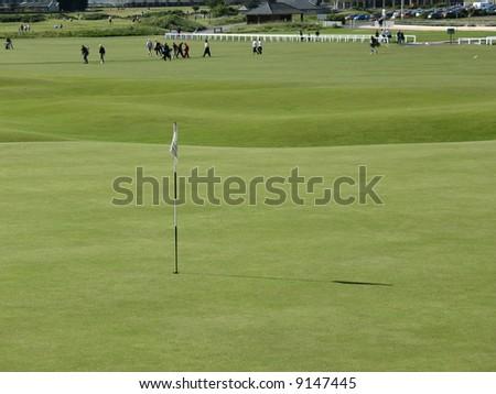 golfers on st andrews golf course scotland - stock photo