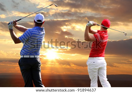 Golfers on training field - stock photo