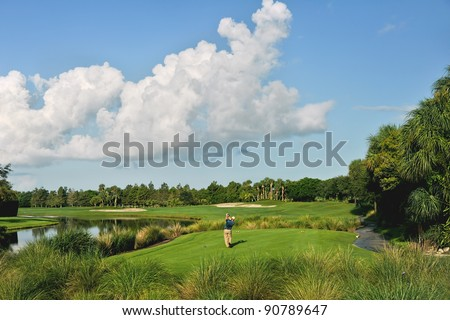 golfers tee off at golf course in the morning - stock photo