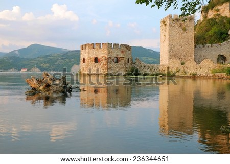 Golubac Fortress octagonal tower on the bank Danube River, Serbia - stock photo