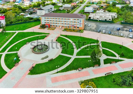 Golyshmanovo, Russia - August 21, 2015: Aerial view on Niva hotel and park with fountain - stock photo