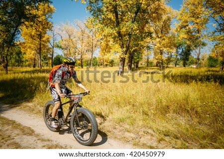 Gomel, Belarus - August 9, 2015: Mountain Bike With Fat Tires Cyclist Riding Track At Sunny Day, Healthy Lifestyle Active Athlete Doing Sport. - stock photo
