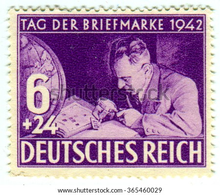GOMEL,BELARUS - JANUARY 2016: A stamp printed in Germany shows image of the German philatelists, circa 1942.  - stock photo