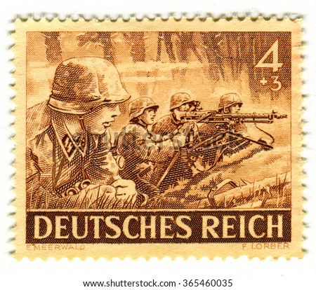 GOMEL,BELARUS - JANUARY 2016: A stamp printed in Germany shows image of the German soldiers, circa 1943. - stock photo