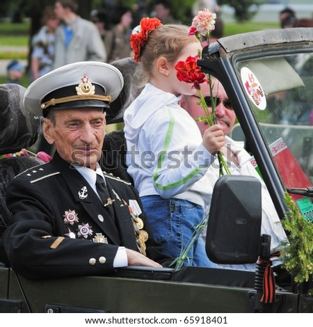 GOMEL, BELARUS - MAY 9: An unidentified war veteran in a jeep looks on during WW2 victory war parade day on May 9, 2010 in Gomel, Belarus.