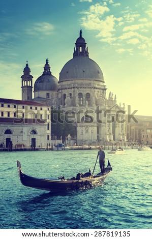 Gondola and Basilica Santa Maria della Salute, Venice, Italy - stock photo