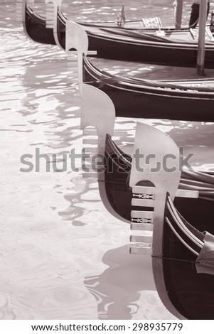 Gondola Boat on the Grand Canal, Venice, Italy in Black and White Sepia Tone - stock photo