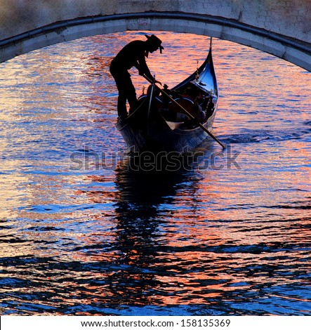 gondola in venice with beautiful colors on the watersurface, Venice Italy  - stock photo