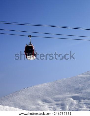 Gondola lift and off piste slope at sun morning. Caucasus Mountains, Georgia. Ski resort Gudauri. - stock photo