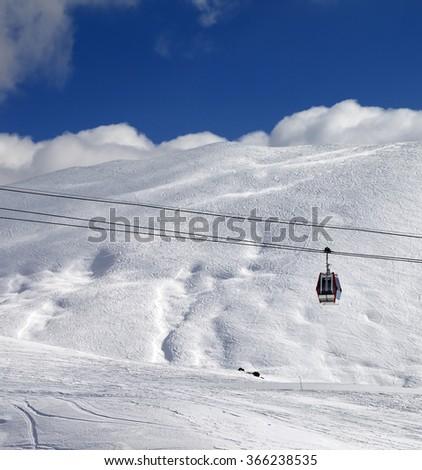 Gondola lift and ski slope at sun day. Caucasus Mountains, Georgia, region Gudauri. - stock photo