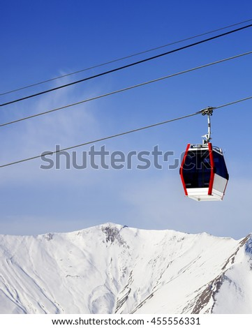 Gondola lift and snowy mountains at ski resort. Caucasus Mountains, Georgia, region Gudauri.