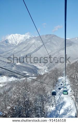 Gondola lift in Krasnaya Polyana ski resort, Sochi, Russia - stock photo