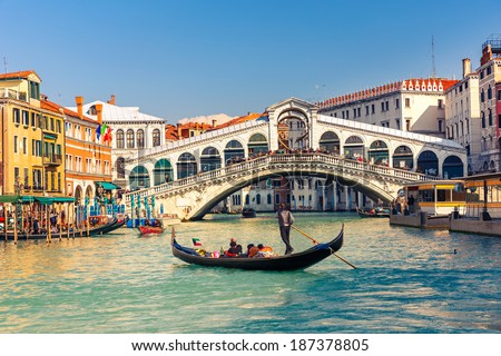 Gondola near Rialto Bridge in Venice, Italy - stock photo