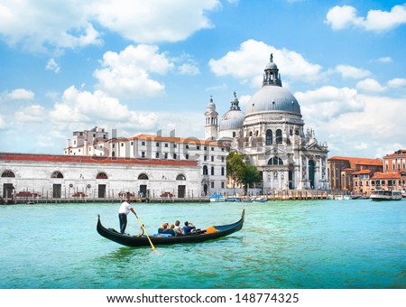 Gondola on Canal Grande with Basilica di Santa Maria della Salute in the background, Venice, Italy - stock photo