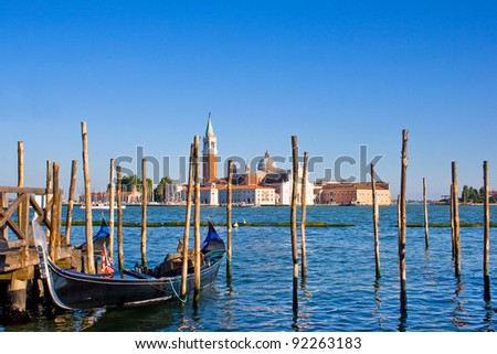 Gondola on Canal Grande with San Giorgio Maggiore church in the background as seen from San Marco, Venice, Italy - stock photo