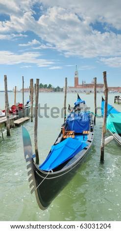 Gondola on the San Marco canal and Church of San Giorgio Maggiore in Venice, Italia. - stock photo