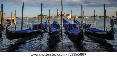 Gondola's in Venice, Italy, seen againts the backdrop of the Church of the San Giorgio Maggiore.