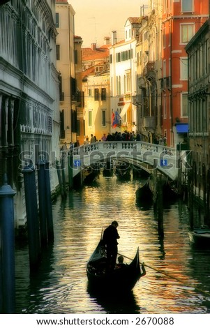 Gondola silhouette on venetian canal at evening. - stock photo