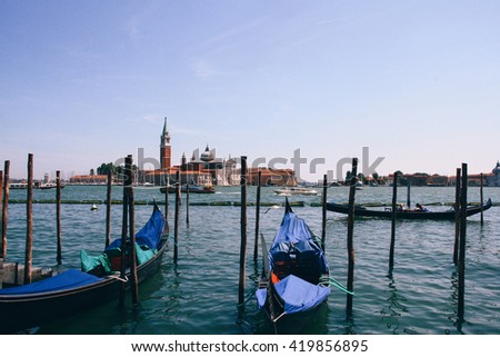 Gondolas along the Grand Canal in Venice (Italy) with Church of San Giorgio Maggiore in the background. - stock photo