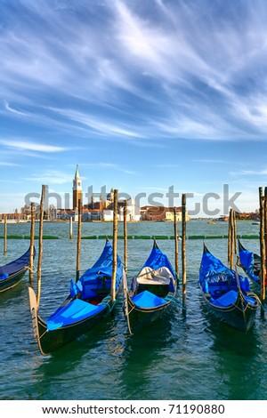 Gondolas anchored on Grand Canal in Venice - stock photo
