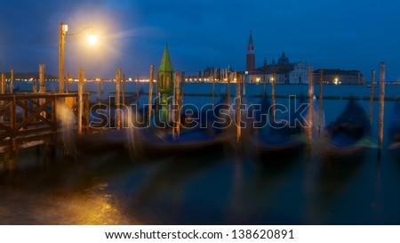 Gondolas at long time and San Giorgio Maggiore Basilica by Night - stock photo
