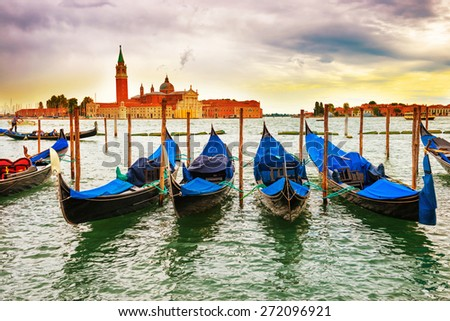 Gondolas at sunset near the Piazza San Marco, Venice, Italy. - stock photo