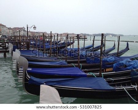 Gondolas at the pier in Venice
