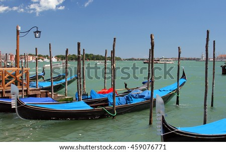 Gondolas at Venetian Lagoon near San Marco square. Venice, Italy. July, 2007.