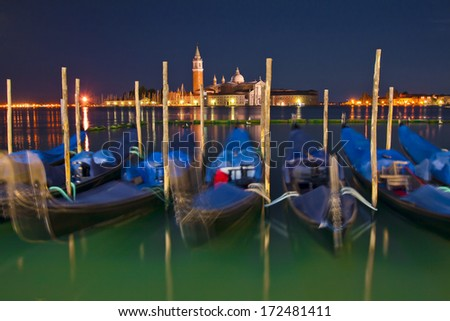 Gondolas by night at the Piazza San Marco, Venice, Italy. - stock photo