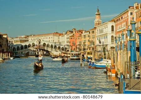 Gondolas crossing on Canal Grande, near Ponte Rialto, in Venice, Italy - stock photo