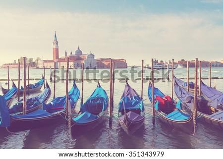 Gondolas floating in the Grand Canal, Venice, Italy, retro toned - stock photo