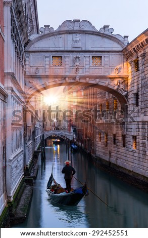 Gondolas floating on canal towards Bridge of Sighs (Ponte dei Sospiri). Venice, Italy - stock photo