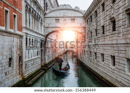 Gondolas floating on canal towards Bridge of Sighs (Ponte dei Sospiri). Venice, Italy - stock photo