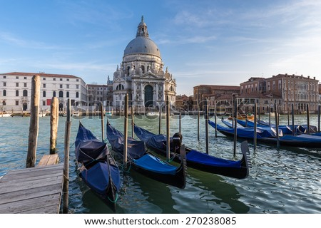 Gondolas in Grand Canal and Basilica Santa Maria della Salute in Venice, Italy. - stock photo