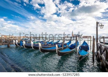 Gondolas in lagoon of Venice , Italy