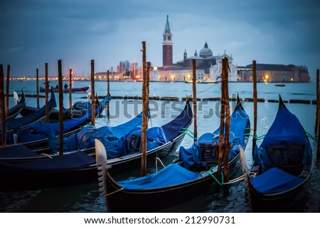 Gondolas in night time at the Piazza San Marco, Venice, Italy. - stock photo