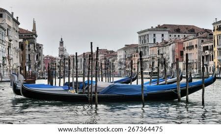 Gondolas in pier near Grand Canal, Venice - stock photo