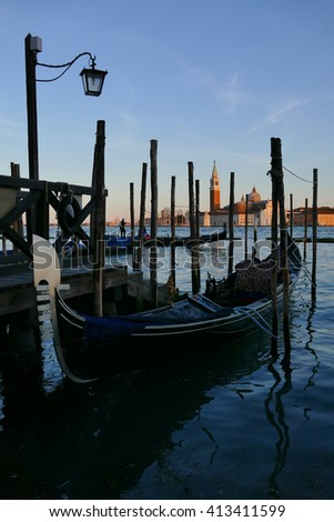 Gondolas in the evening light on the lagoon in Venice, Italy