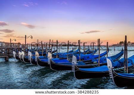 Gondolas in Venice - sunset with San Giorgio Maggiore church. San Marco, Venice, Italy - stock photo
